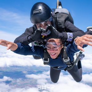 Tandem skydive heart with hands